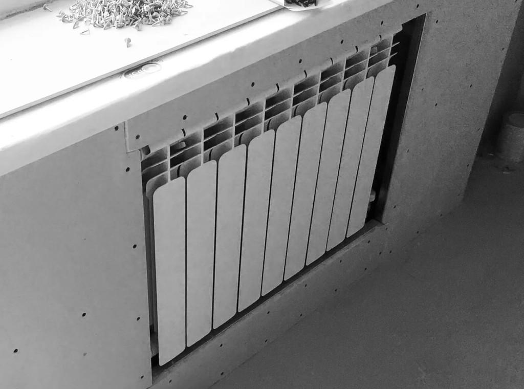 отделка вокруг радиатора  гипсокартоном